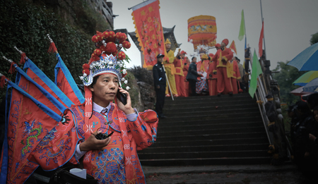 participant: Participant of the parade talking on mobile phone