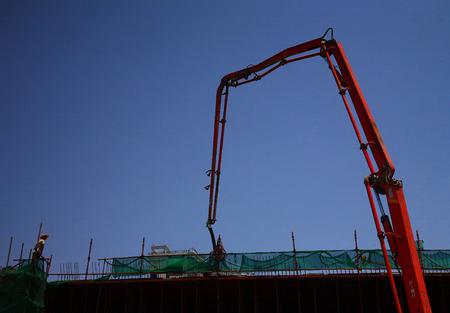 concrete pump: Concrete pump at work on a construction building