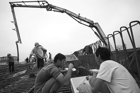 PUMPER: Construction workers having a lunch break at the construction site