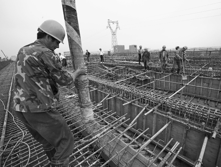 concrete pump: Construction worker manning the concrete pump Editorial