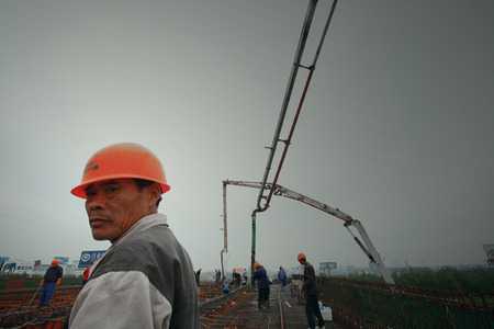 PUMPER: Construction worker on top of a construction building