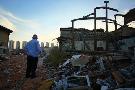 dystopia: An elderly man standing in a rubble site Stock Photo