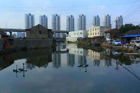 urbanization: Cityscape of a village going through urbanization Editorial