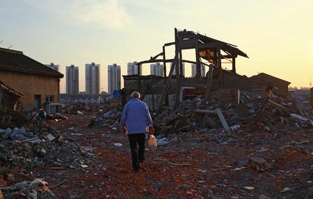 dystopia: An elderly man walking through the rubble