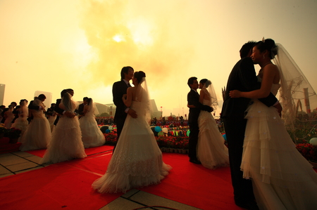 joyous festivals: Newlyweds dancing under the sunlight