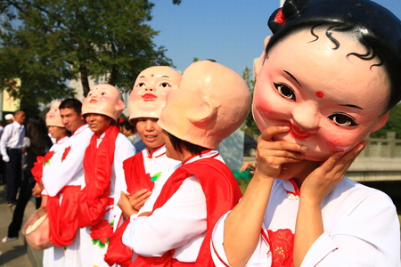 performers: Performers wearing doll heads