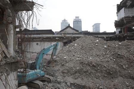 demolish: Tractor at a demolition site