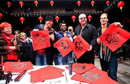 works: Tourists showing their calligraphy works