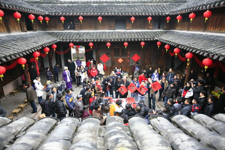 chinese courtyard: Tourists and villagers gather together for the spring festival Editorial