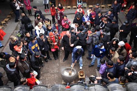 pounding: Villager pounding rice cake for spring festival