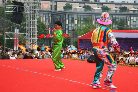performing: Juggler and clown performing on stage