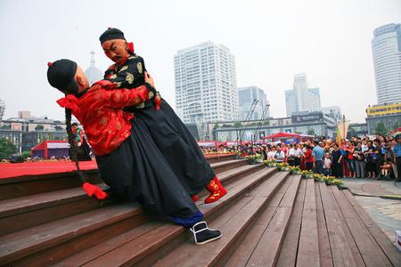 er: Crowd watching the performance of er gui shuai jiao Editorial