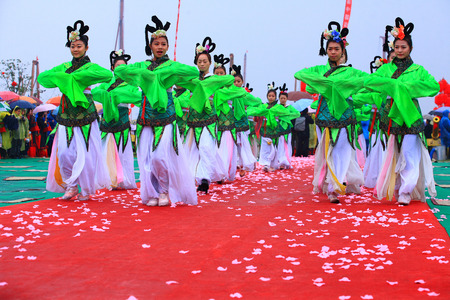performing: Dancers performing on a red carpet
