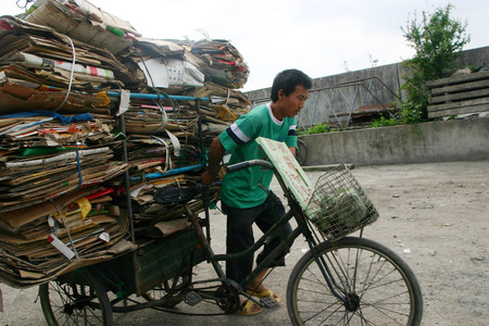 loaded: A man with a loaded cargo tricycle