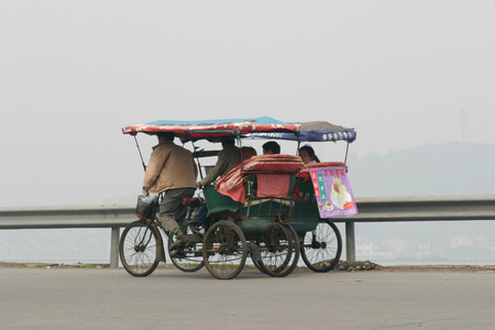 rickshaw: View of people on the tricycle rickshaw