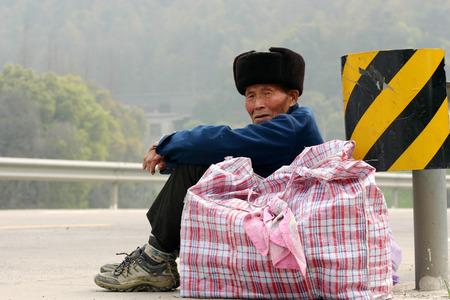 road side: Senior man sitting at the road side