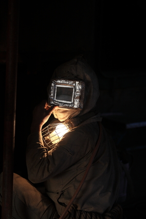 equipping: Worker equipped with mask and goggles for protection Stock Photo