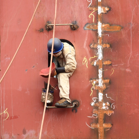 shipbuilder: Worker working on a constructing vessel
