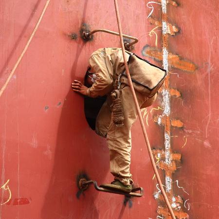 shipbuilder: Worker entering window of a constructing vessel