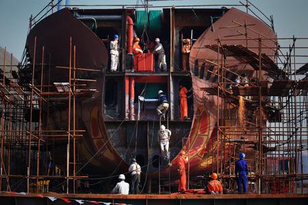 shipyard: Workers in a shipyard Editorial
