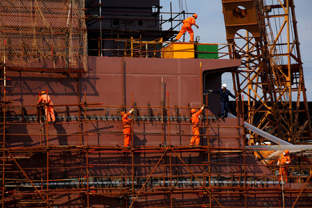 shipbuilder: Workers in a shipyard Editorial