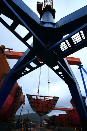 shipbuilder: A crane picking up a vessel structure Editorial