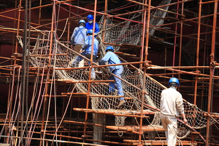 shipbuilder: Workers walking the stairs Editorial