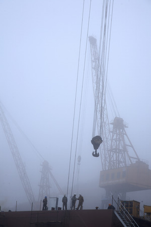 shipbuilder: Workers working at a shipyard