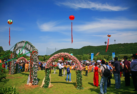 outdoor event: People gathering at a field during an outdoor event