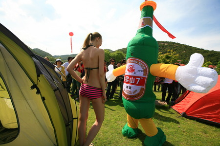 outdoor event: A model and a beer mascot at the outdoor event Editorial