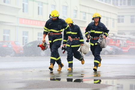 only three people: A fire squadron training