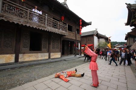 acting: People in traditional Chinese clothing acting out a scene