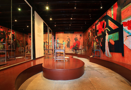wall paintings: Wall paintings with chairs in a gallery