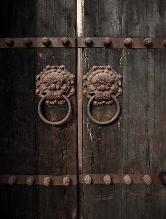 door knobs: Ancient door knobs on old wooden door Stock Photo