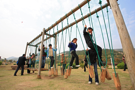 13 14 years: People playing at the playground