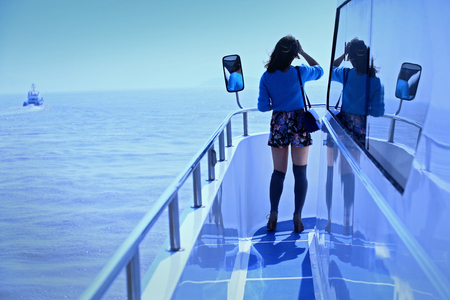 full length mirror: Lady standing at the edge of a cruise ship