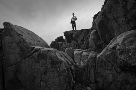 one mature man only: Man standing on top of a mountain