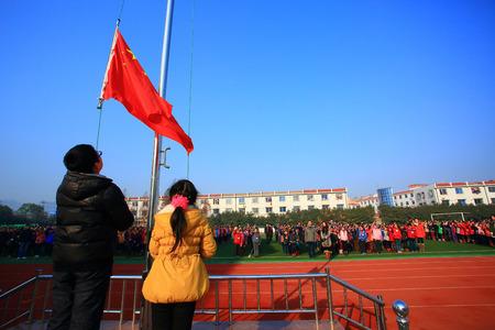10 12 years: Students raising flag of China
