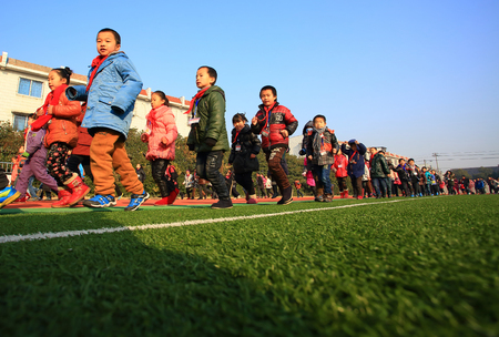 12 13: Students running on the field