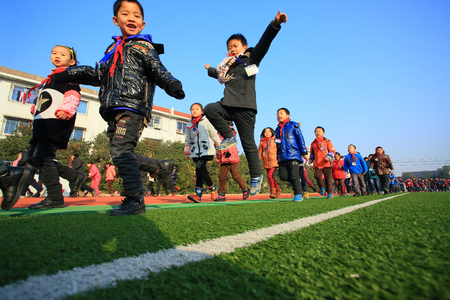 12 13: School children running around the field