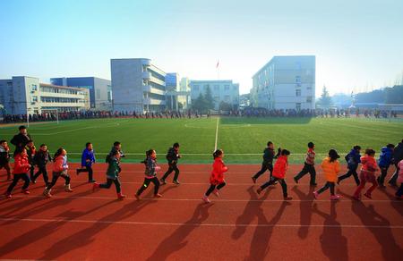 dormitory: School children running around the field