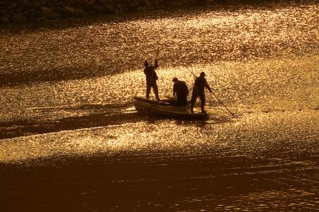 only three people: People in boat at Hengjie town reservoir
