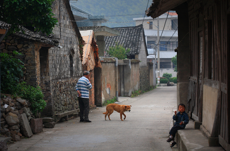 villagers: Villagers with pet dog on the street