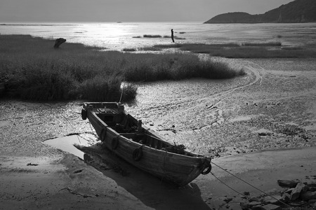 wooden boat: Wooden boat by the bay