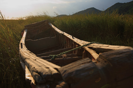 sunglight: Wooden boat on the field