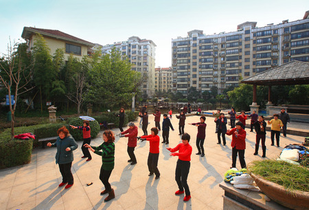 residence: Residence practicing Tai Chi at park