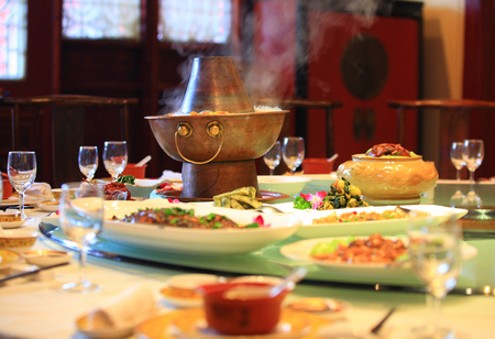 steamboat: Steamboat and various dishes served on a table