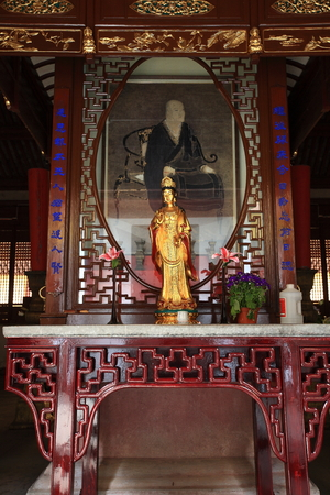 altar: Guanyin statue on an altar table