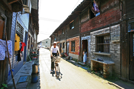 60 64 years: An old man riding bicycle on the road