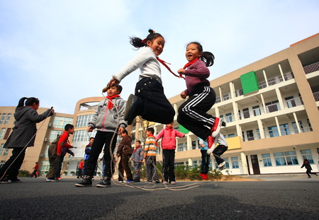 10 years girls: Students skipping rope in school